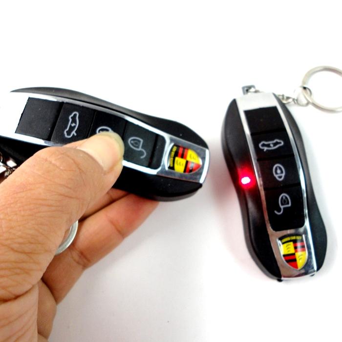 4 in 1 Porsche Shaped Electric Shock Keychain, Fake Remote Control Keychain for Car/ Bike Shock Key Rain (LED Torch + Laser Light + Shock + Key Rain)